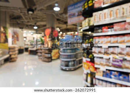 Product shelf, Supermarket in blurry for background - stock photo