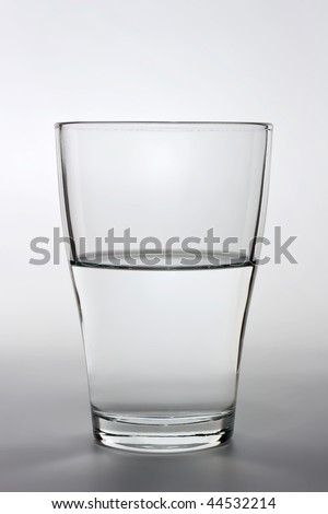 product shot of an half full water glass - stock photo