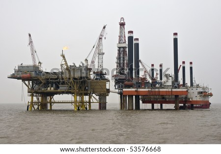 Production and Drilling Platforms working together - stock photo