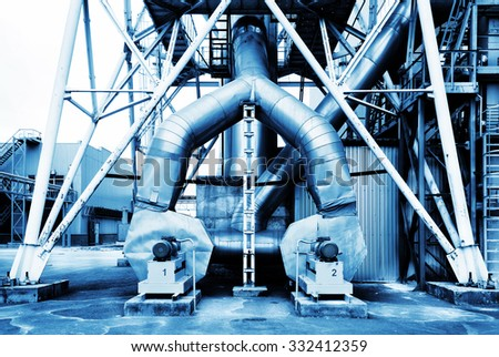 Production capacity of electric motors toned in blue - stock photo