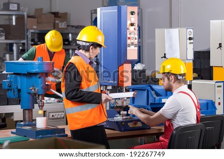 Production male worker with his boss, horizontal - stock photo
