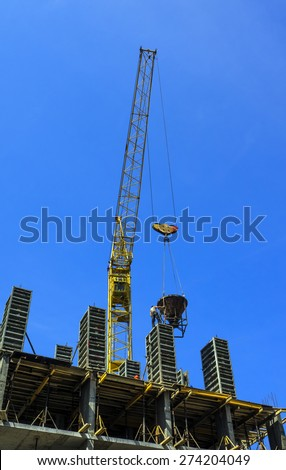 Production of monolithic structures under construction building - stock photo