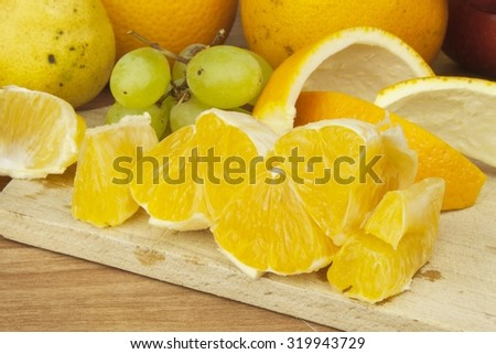 Production of summer fruit juices. Domestic fresh orange juice in a glass jar on a wooden table. Hand-prepared homemade orange juice. Healthy drink for athletes. Place for your text. Sales of juices. - stock photo