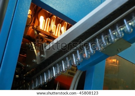 Production of the bottles plastic The Technological line on production of the plastic bottles. Conveyor automatic - stock photo