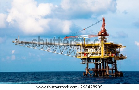 Production platform in offshore oil and gas industry. The platform with blue sky