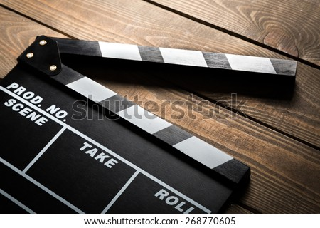 Production. Vintage photo of movie clapper on wood - stock photo