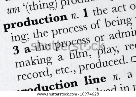 Production word dictionary definition closeup - stock photo