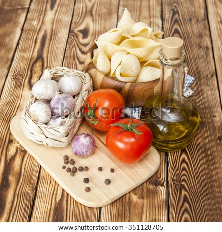 Products and kitchen utensils for cooking of paste with tomato sauce - stock photo