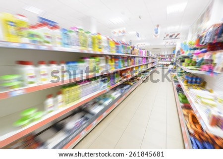 Products in row in a supermarket, motion blur. - stock photo