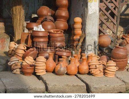 Products made of red clay. Pottery of different sizes exhibited in the street  - stock photo