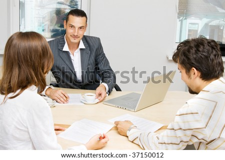 Professional adviser having a discussion with a customer - stock photo