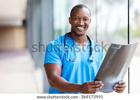 professional african medical doctor holding CT scan - stock photo