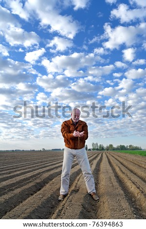 Professional agronomist testing ground on the field. - stock photo