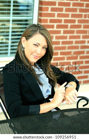 Professional and Attractive Brunette Business Woman Smiling While Checking the Time - stock photo