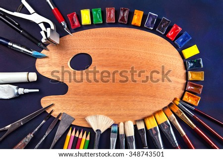 Professional art materials on vintage background - stock photo