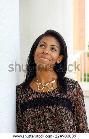 Professional Attractive African American Business Person Woman With Black Hair Smiling and Looking Up - stock photo