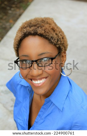 Professional Attractive African American Business Person Woman With Black Hair Wearing Glasses Smiling - stock photo