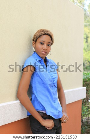 Professional Attractive African American Business Woman Person Black Hair  Serious Leaning Against the Wall - stock photo