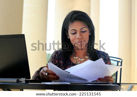 Professional Attractive African American Business Woman Person Black Hair Working on Paperwork Serious - stock photo