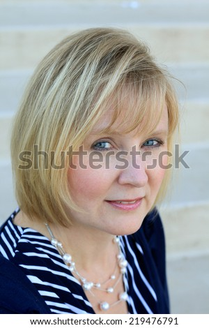 Professional Attractive Blonde Business Woman Wearing Blue Shirt  - stock photo