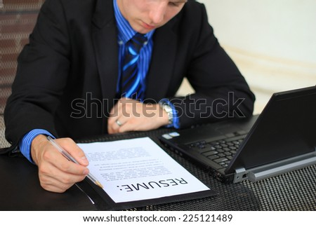 Professional Attractive Business Person Working on Paperwork and on the Computer