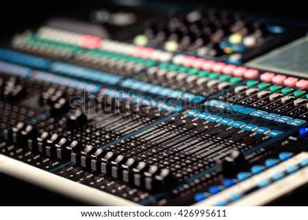 Professional audio mixer in studio - stock photo