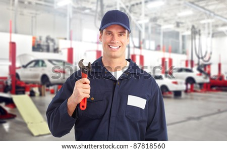 Professional auto mechanic in auto repair shop. Garage. - stock photo