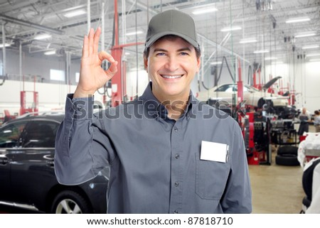 Professional auto mechanic in auto repair shop. Garage. - stock photo