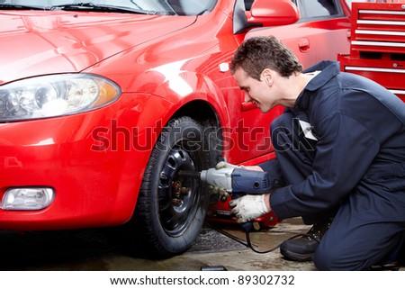Professional auto mechanic v in auto repair shop. Garage. - stock photo