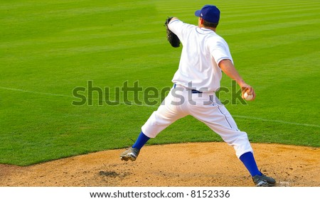 Professional baseball pitcher throwing the ball - stock photo