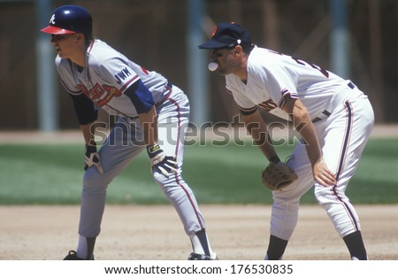 Professional Baseball player Will Clark chewing gum and watching pitcher during game, Candlestick Park, San Francisco, CA - stock photo