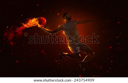 Professional basketball player is shoting the fireball - stock photo