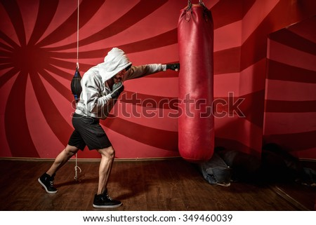 professional boxer training at gym, practicing kicks and punches - stock photo