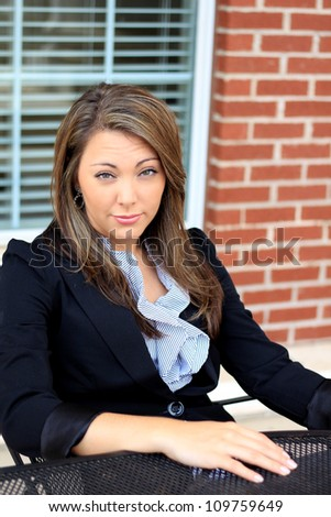 Professional Brunette Business Woman Sitting While Serious - stock photo