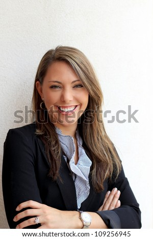 Professional Brunette Business Woman Smiling Arms Crossed - stock photo