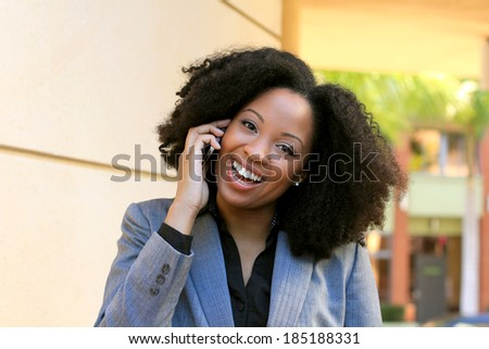 Professional Business African American Executive Businesswoman Talking on the Cell Phone Playful and Happy - stock photo