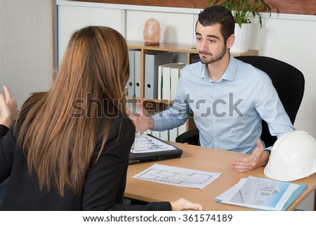 Professional business man and woman sitting  in the office