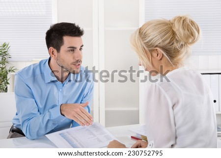 Professional business meeting: consultant explain his female customer the risc and possibilities of provision for one's old age. - stock photo