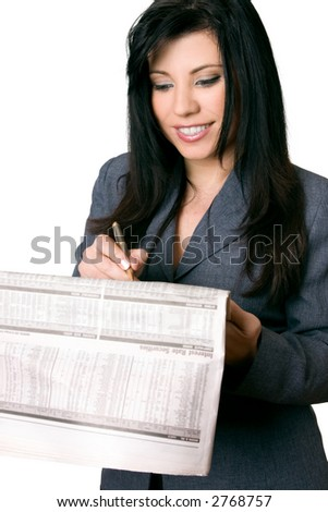 Professional business woman reading and writing on the finance newspaper with a pen.