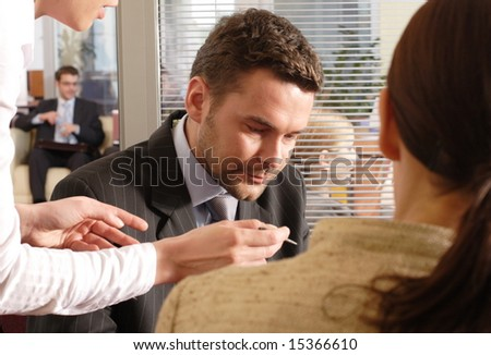 Professional businesspeople in an office environment. - stock photo