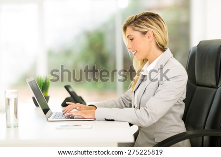 professional businesswoman working on laptop computer - stock photo