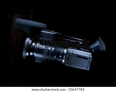 Professional  camcorder  on black  background  for  next  design - stock photo