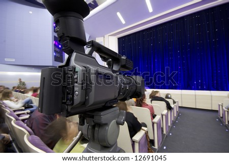 professional camera on the performance, focus on camera - stock photo