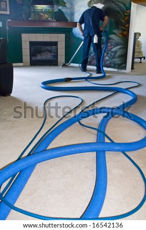 Professional carpet cleaner working on floors at a home - stock photo