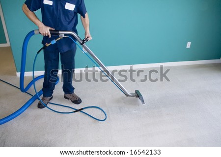 Professional Carpet Steam Cleaner Vacuuming a Home - stock photo