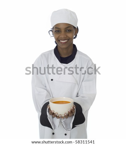 Professional chef in work-wear jacket serving soup isolatated on white - stock photo