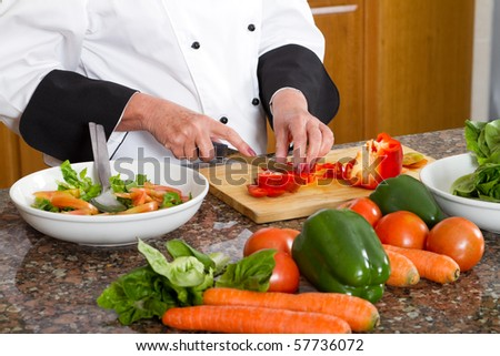 professional chef making salad