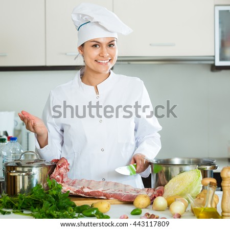 Professional chef with the ribcage cooking at a kitchen table