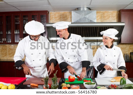 professional chefs cooking in industrial kitchen - stock photo