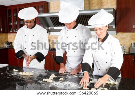 professional chefs in kitchen - stock photo